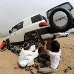 Saudi youths lift their sport utility ve